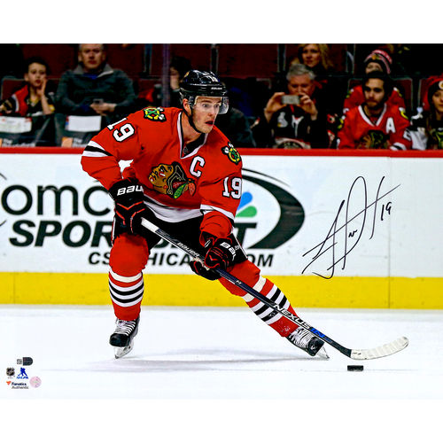 "Jonathan Toews Chicago Blackhawks Autographed 16"" x 20"" Red Jersey Skating with Puck Photograph No Size by Fanatics Authentic"