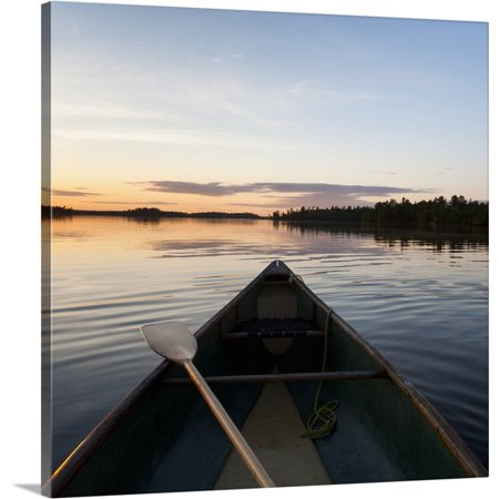 Premium Canoe Paddle Wall Decor - Great BIG Canvas | Keith Levit Premium Thick-Wrap Canvas entitled A Boat And Paddle On A Tranquil Lake At Sunset, Ontario, Canada