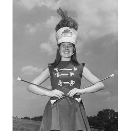 Drum Majorette Costume (Drum majorette performing with two twirling batons and smiling Poster Print (8 x)
