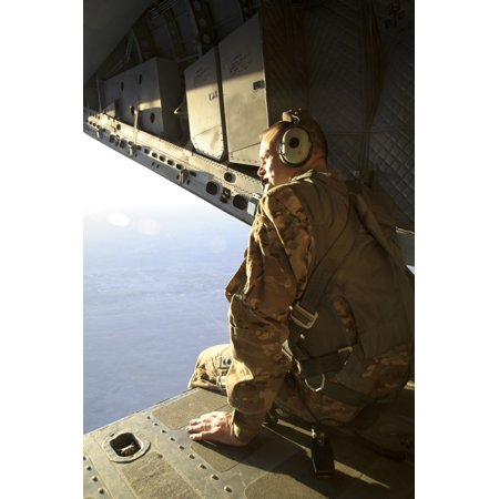 October 24 2011 - US Air Force Commander sits harnessed on the back ramp of an Afghan Air Force C-27 Spartan as it flies over Helmand province Afghanistan Poster Print