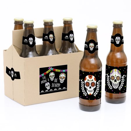 Day Of The Dead - Halloween Sugar Skull Party Decorations for Women and Men - 6 Beer Bottle Label Stickers and 1 Carrier Want to bring a unique gift to a party Our Day Of The Dead - 6 Halloween Sugar Skull Beer Bottle Label Stickers and 1 Carrier are the perfect gift for the party. This set comes with a craft paper carrier and with 6 soda or beer bottle labels that are printed on sticker paper that is waterproof. Apply labels to room temperature bottles. Apply beer bottle labels either after removing original label for best results or put over existing labels if you choose. Chill after you are done applying labels. For the two larger labels that are left over apply to the front and back of paper carrier. Use the two smaller ones to put on each end of the paper carrier to give you the completed look. (Beer in image is obviously NOT included).Set of 6 will decorate 6 bottles and 4 labels for decorating the kraft paper carrier. Labels are printed on sticker paper that is waterproof, made in the USA.The main sticker label is 3.5  x 3  and the collar/neck sticker label is 3.5  long x 1.5  wide at the center.Apply labels to room temperature bottles. Apply beer bottle labels either after removing original label for best results or put over existing labels if you choose. Chill after you are done applying labels. (Beer in image is NOT included).