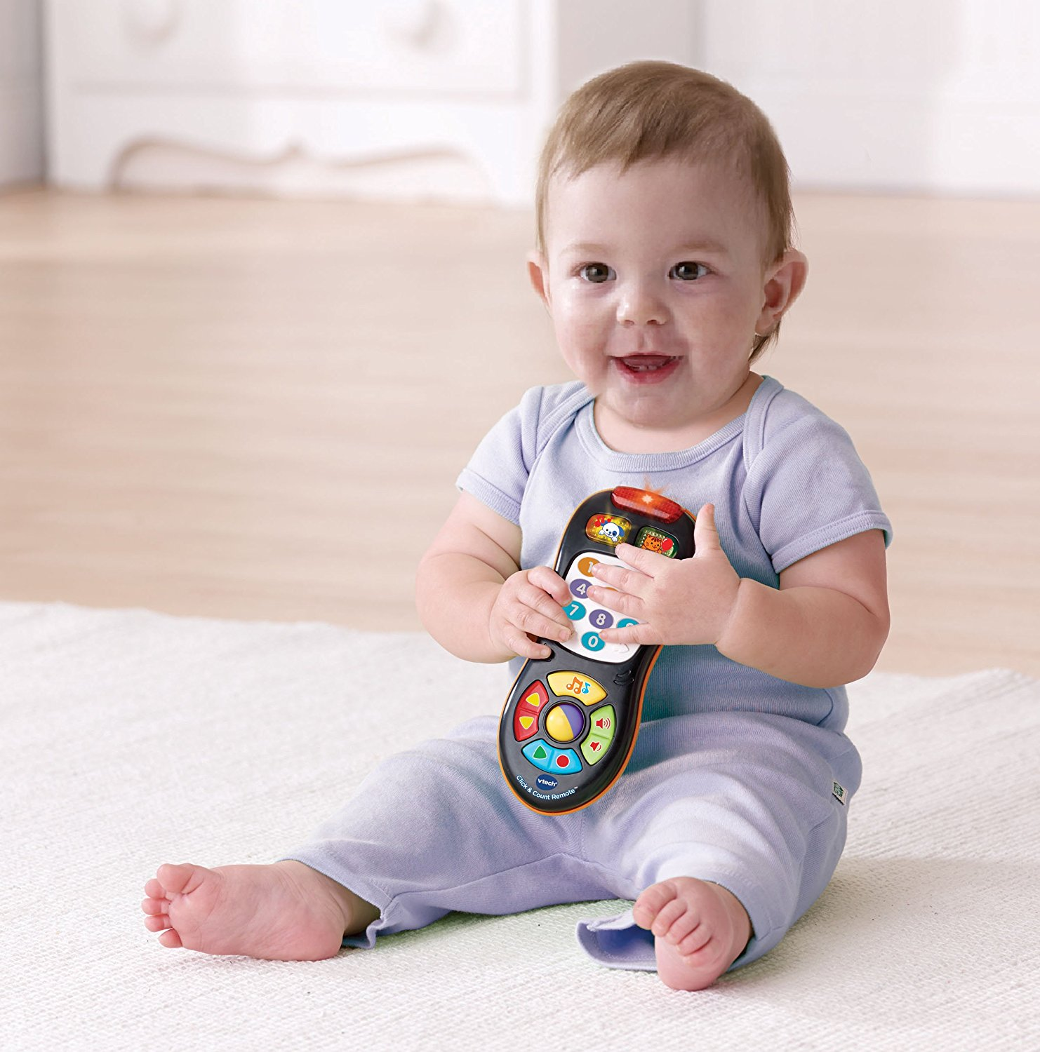 VTech Click and Count Remote with 45 sing-along songs and 9 pretend channels New! by