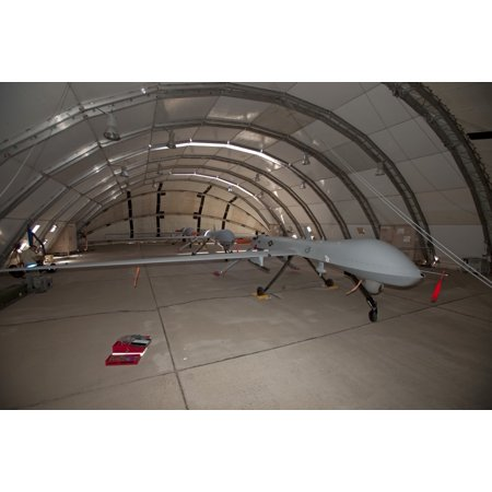 Maintence crews from the 49th Fighter Wing at Holloman Air Force Base New Mexico work on MQ-1 Predators in a shelter Poster -