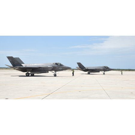 LAMINATED POSTER Two U.S. Navy Lockheed Martin F-35C Lightning II Joint Strike Fighter aircraft from Strike Fighter S Poster Print 24 x 36