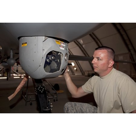 A crew chief works on MQ-1 Predators MTS-A camera system Canvas Art - HIGH-G ProductionsStocktrek Images (35 x 23)