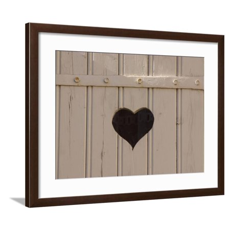 A White Picket Fence with a Black Heart Cut Out Framed Print Wall Art