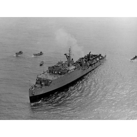 The U.S. Navy dock landing ship USS Catamount (LSD-17) surrounded by small craft as she offloads amp Poster Print 24 x 36