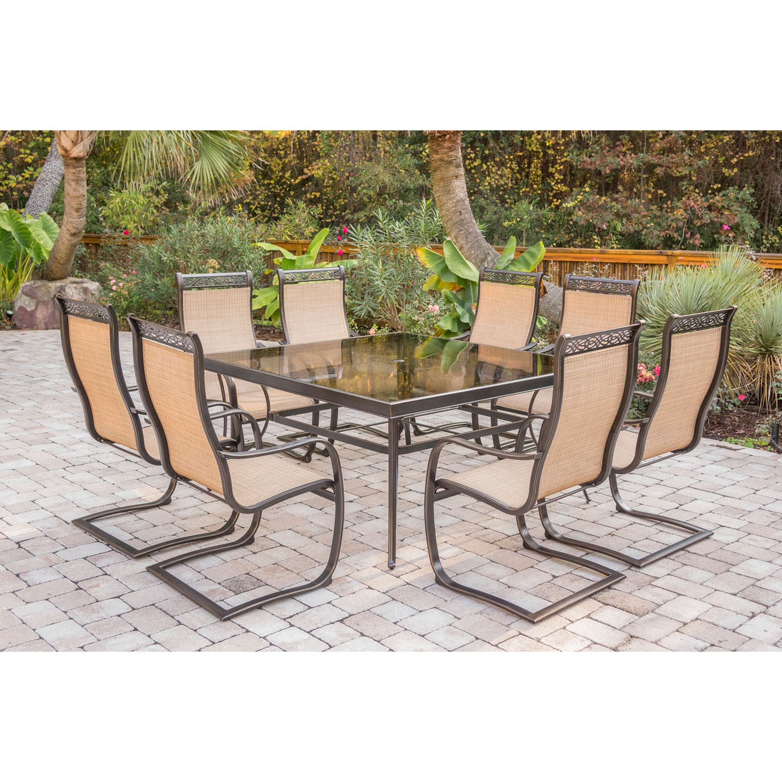 """Hanover Outdoor Monaco 9-Piece Sling Dining Set with 60"""" Square Glass-Top Table and 8 C-Spring Chairs in Cedar"""