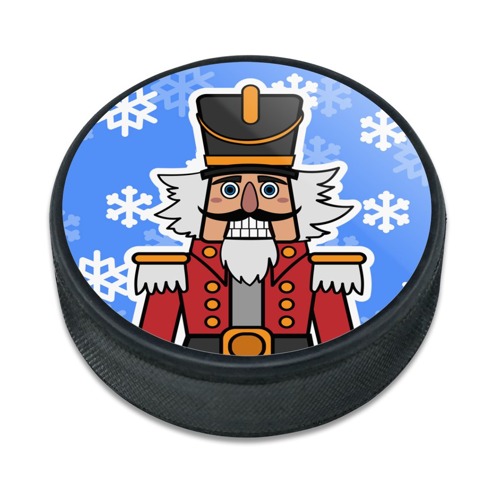 Grinning Nutcracker Soldier with Snowflakes Ice Hockey Puck