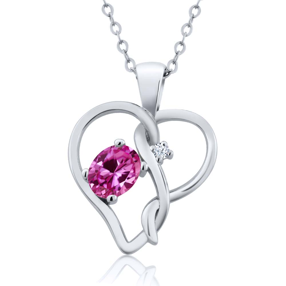 0.51 Ct Oval Pink Created Sapphire 18K White Gold Pendant by