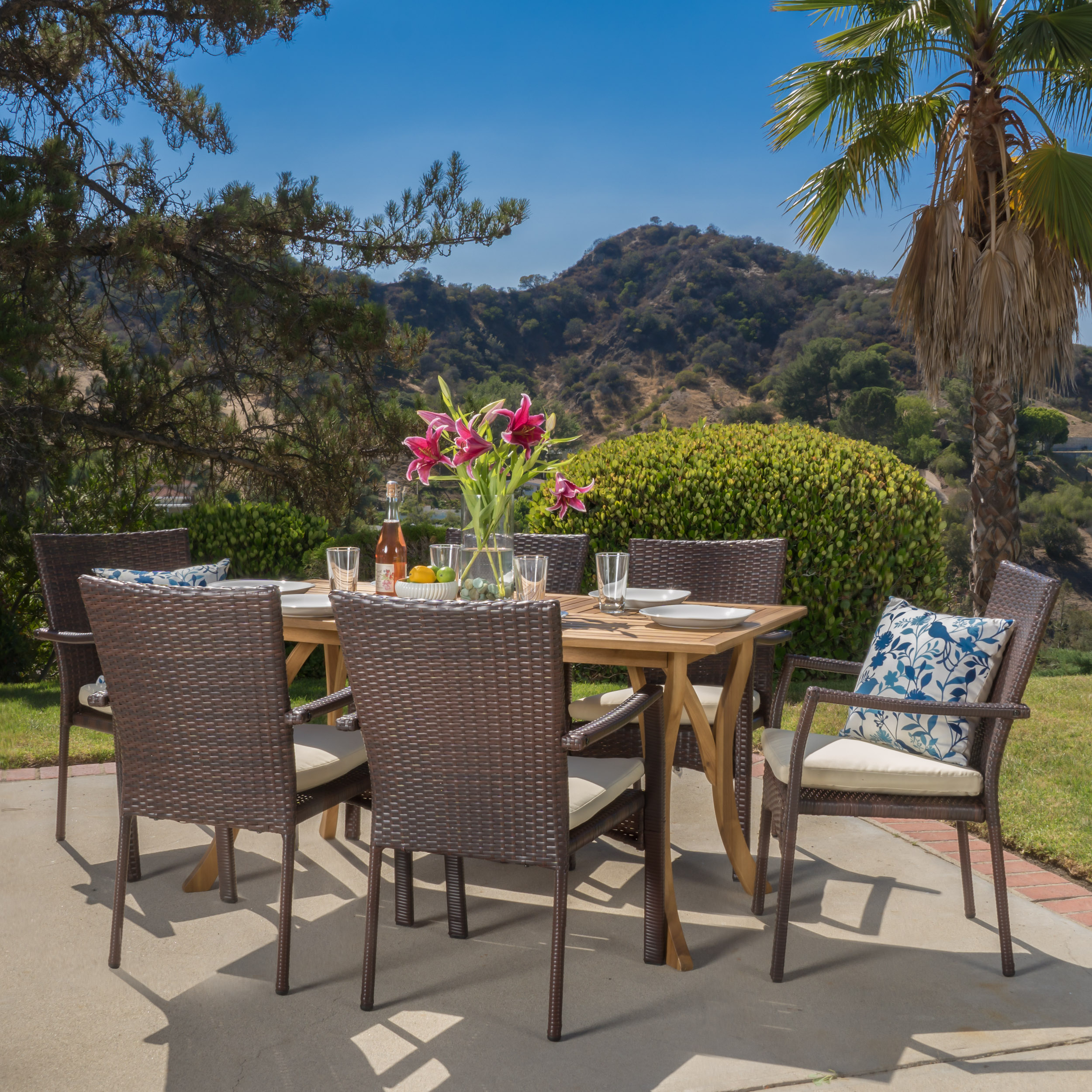 Ruiz 7 Piece Outdoor Wicker and Acacia Wood Dining Set with Cushions, Teak Finish, Creme