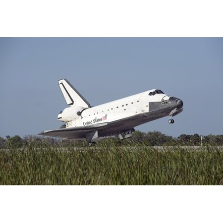 Cape Canaveral Florida - Space shuttle Atlantis touches down on Runway 33 at the Shuttle Landing Facility at the Kennedy Space Center in Florida Poster Print