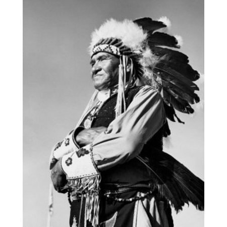 Image of Winnebago man standing with his arms crossed Canvas Art - (24 x 36)