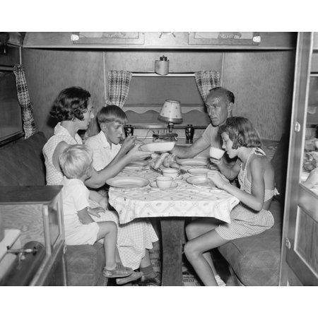 American Family Dining At The Table In Their Trailer Camper June 4