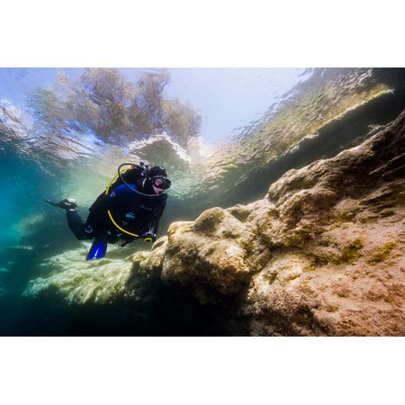 Diver exploring a spring in Santa Rosa New Mexico Poster Print by Jennifer IdolStocktrek Images