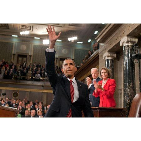 President Obama Waves To The First Lady And Guests Seated In The Gallery Of The House Chamber After Delivering An Address To A Joint Session Of Congress In The Background