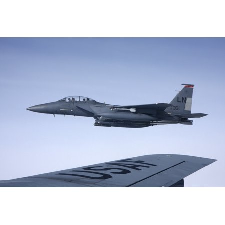 US Air Force McDonnell Douglas F-15E Strike Eagle over the wing of a Boeing KC-135 Stratotanker Poster Print