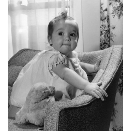 Baby girl with toy on armchair Canvas Art - (18 x 24)
