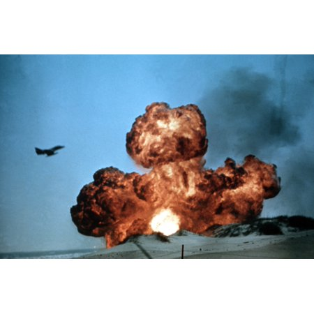 LAMINATED POSTER A U.S. Marine Corps Douglas TA-4F Skyhawk flies over a bomb explosion during a training exercise in Poster Print 24 x 36