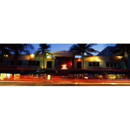 Traffic in front of a building at dusk Art Deco District South Beach Miami Beach Miami-Dade County Florida USA Stretched Canvas - Panoramic Images (36 x