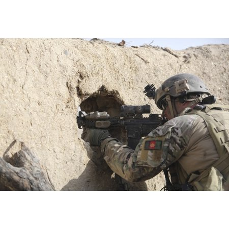 A US Special Forces Soldier returns fire from an outpost in Afghanistan Canvas Art - Stocktrek Images (34 x
