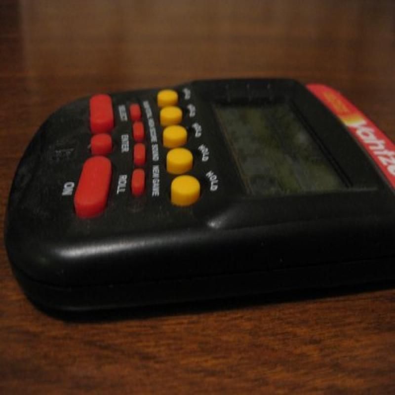 Milton Bradley Yahtzee Handheld Electronic Game (1995)