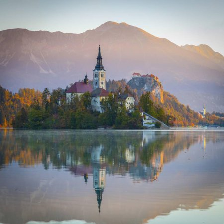 Bled Island with the Church of the Assumption and Bled Castle Illuminated at Dusk, Lake Bled Print Wall Art By Doug Pearson