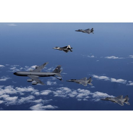 LAMINATED POSTER F15 Strike Eagles and a F22 Raptor from the 325th Fighter Wing, Tyndall AFB, Fla. participate in an Poster Print 24 x 36