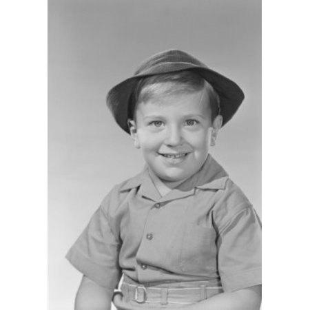 Studio portrait of boy in boy scout uniform Canvas Art - (24 x 36)