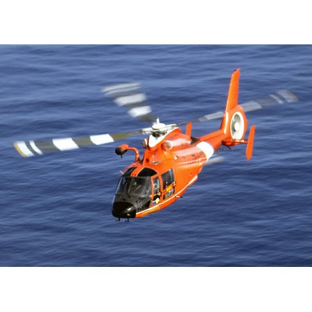 A Coast Guard HH-65A Dolphin rescue helicopter in flight Poster Print by Stocktrek Images