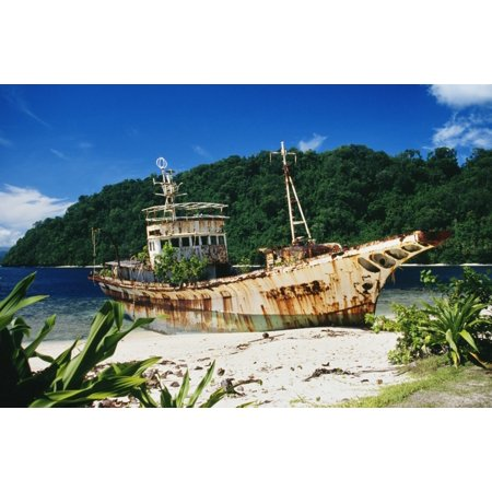 Shipwrecked fishing boat on beach Papua New Guinea Canvas Art - Peter Stone Design Pics (19 x 12)