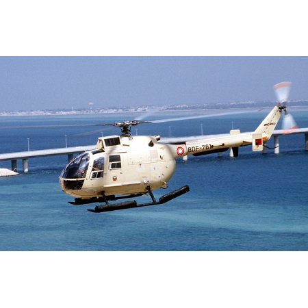 LAMINATED POSTER A BO-105 helicopter of Bahrain flies inland near a causeway in the aftermath of Operation Desert Sto Poster Print 24 x 36 ()