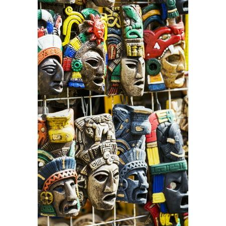 Close up of colourfully painted Mayan masks hanging on display Akumal Quintana Roo Mexico Stretched Canvas - Michael Interisano  Design Pics (12 x 19) ()
