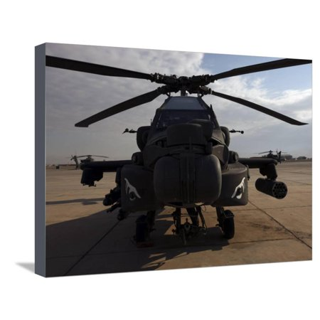 AH-64 Helicopter Sits on the Flight Line at Camp Speicher Stretched Canvas Print Wall Art By Stocktrek Images