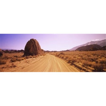 Dirt road passing through an arid landscape  Californian Sierra Nevada  California  USA Poster Print by  - 36 x 12 - image 1 of 1