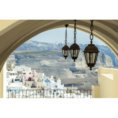 Snowflakes To Hang From Ceiling (Lights hang from an arched ceiling with a view of a church whitewashed buildings and landscape Fira Santorini Greece Stretched Canvas - Dosfotos  Design Pics (19 x)