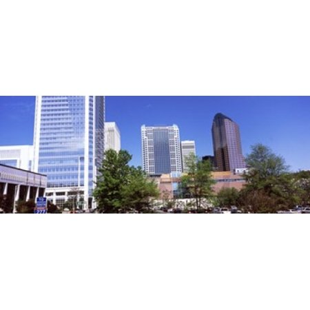 Downtown modern buildings in a city Charlotte Mecklenburg County North Carolina USA 2011 Canvas Art - Panoramic Images (15 x 6)