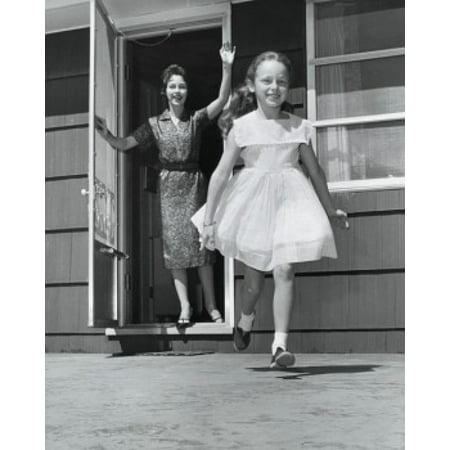 Mid adult woman standing in the doorway and waving to her daughter Canvas Art -  (24 x 36)](Halloween Doorway)