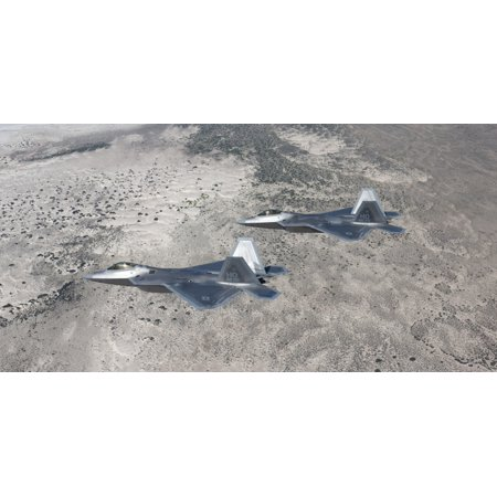 Two F-22 Raptors from the 49th Fighter Wing flies in formation on a training mission out of Holloman Air Force Base New Mexico Poster Print
