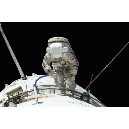 August 22 2013 - Russian cosmonaut attired in a Russian Orlan spacesuit participates in a session of extravehicular activity to continue outfitting the International Space Station Poster Print