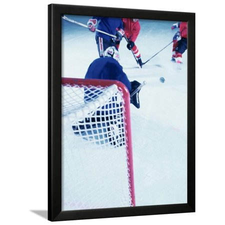 High Angle View of Ice Hockey Players Surrounding The Goal Framed Print Wall Art