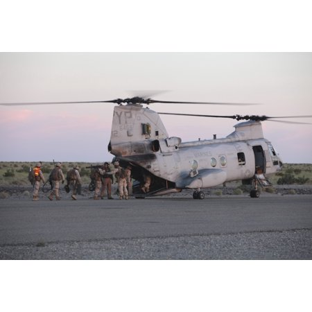 - May 5 2010 - US Marines board a CH-46 Sea Knight helicopter to conduct training in night operations at Marine Corps Air Station Yuma Arizona Poster Print