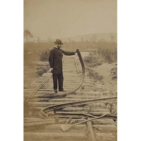 Military railroad operations in northern Virginia man standing on railroad tracks holding twisted rail Poster Print by unknown