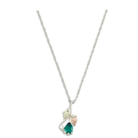 - Sterling Silver Black Hills Gold Pendant with 7X5MM Synthetic Soude Emerald Stone and 12K Leaves