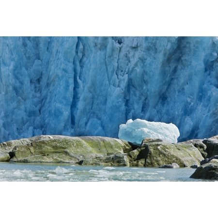 An Iceberg Rests On The Top Of Boulders After Being Tossed On Shore By The Tidal Wave From Calving Dawes Glacier In The Background Endicott Arm Southeast Alaska Summer Canvas Art - Ray Bulson  Design