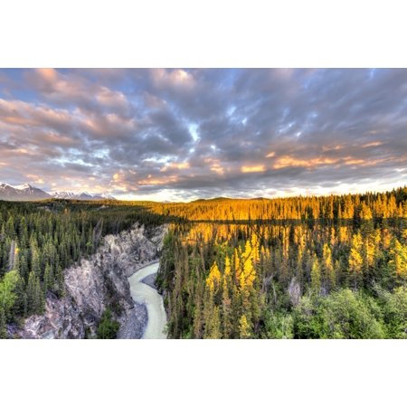 Scenic view of the Kuskulana River Canyon and Wrangell Mountains at sunset from the Kuskulana River Bridge on the McCarthy Road in Wrangell-St Elias National Park and Preserve Southcentral Alaska Spri