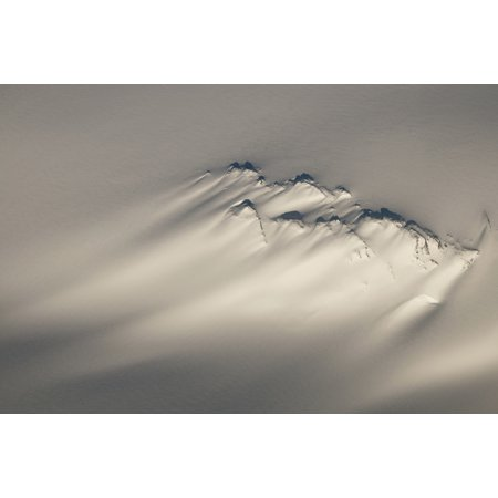 Aerial Of A Windswept Nunatak On The Harding Ice Field In Kenai Fjords National Park Southcentral Alaska Winter Posterprint