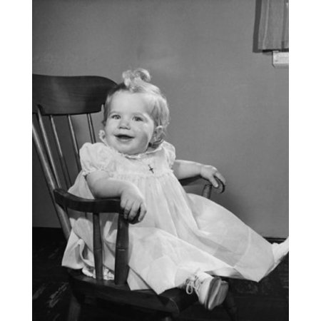 Baby girl sitting in an armchair and smiling Canvas Art - (18 x 24)