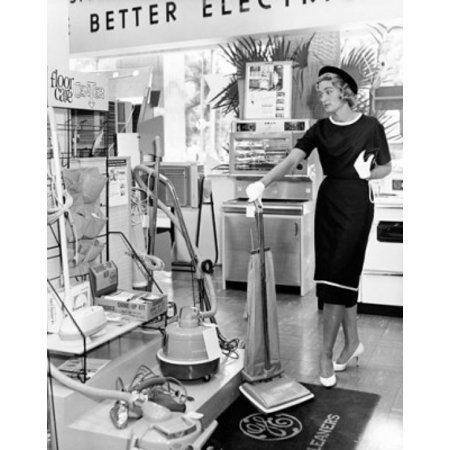 Young woman holding a vacuum cleaner in a store Poster (Young Women Stores)