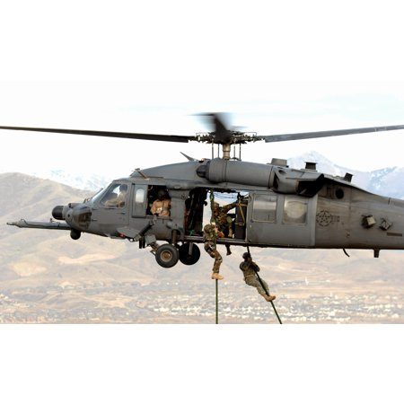 Army personnel from the Utah National Guard, 19th Special Forces unit are lifted on board an Air For Poster Print 24 x